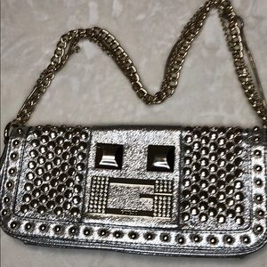 Guess silver clutch with train stub bags